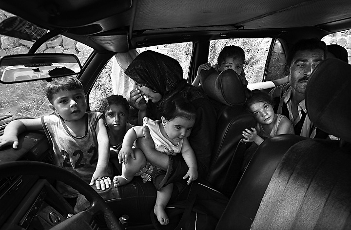 Families from the border towns in Lebanon flee through the very dangerous coastal road between Tyre and Sidon, Lebanon on July 27, 2006.