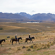 Horse trekking on the top of Mount John overlooking Lake Tekapo and the Mackenzie Country, South Island, New Zealand. 24th February 2011, Photo Tim Clayton.