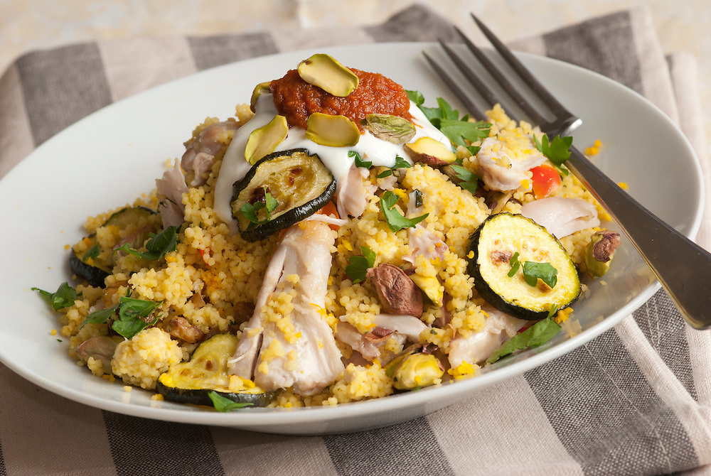 Chicken with couscous, courgette and pistachios topped with harissa paste