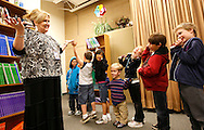 First grader Adam Kotzian (4th R) participates in music class with teacher Viola Terranova (L) at Eagleview Elementary school in Thornton, Colorado March 31, 2010.  Adam and his parents are achondroplasia dwarfs but his sister Avery is not.   REUTERS/Rick Wilking (UNITED STATES)