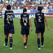 U.S. forward Abby Wambach (20), U.S. defender Stephanie Cox (14), and U.S. forward Sydney Leroux (2) walk toward the fans after an international friendly soccer match between the United States Women's National soccer team and the Russia National soccer team at FAU Stadium on Saturday, February 8, in Boca Raton, Florida. The U.S. won the match by a score of 7-0. (AP Photo/Alex Menendez)