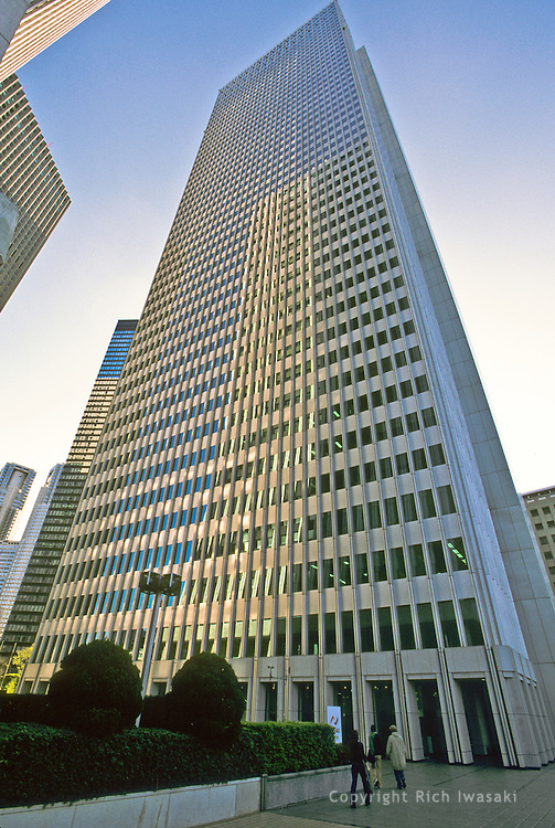 Low angle view of the Nomura building in the Shinjuku district of Tokyo, Japan