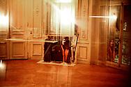 Décembre 2006. Malcolm, membre actif de Jeudi noir. Réunion de travail du collectif. Photo prise dans un squat ouvert par l'association Macaq dans le 8ème arrondissement. <br /> <br /> Le collectif Jeudi Noir se bat contre les prix élevés de l'immobilier pour les jeunes et les bas salaires. Depuis fin octobre 2006, Jeudi noir s'invite lors de visite d'appartement en location, à la vente, dans les agences immobilières ou chez des vendeurs de liste pour y faire la fête et revendiquer un éclatement de la bulle immobilière et un interventionnisme de l'État pour réguler le marché immobilier.  Le 31 décembre 2006, le collectif entame une occupation d'un immeuble vide, appartenant à une banque, près de la place de la Bourse à Paris, avec les associations Macaq et le DAL, baptisé le «ministère de la crise du logement » et qui vise à être un lieu de ressource et d'échange sur la crise du logement en France, et à installer le sujet dans la campagne présidentielle 2007. Série en cours…