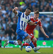 Brighton central midfielder Beram Kayal looks to get the better of Cardiff City striker Joe Mason during the Sky Bet Championship match between Brighton and Hove Albion and Cardiff City at the American Express Community Stadium, Brighton and Hove, England on 3 October 2015. Photo by Bennett Dean.