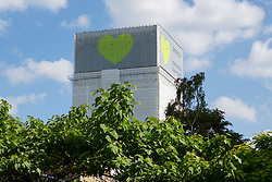Grenfell Tower, now covered in plastic sheeting, one year since the blaze, which claimed 72 lives.
