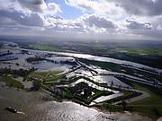 Nederland, Gelderland, Gemeente Zaltbommel; 25-02-2020; Poederoijen, kasteel en fort Loevestein bij hoogwater. In de achtergrond het Munnikenland, overloopgebied. Slot Loevestein is strategisch gelegen op de plaats waar Waal en Maas in het verleden samenkwamen (nu Afgedamde Maas). Loevestein maakt deel uit van de Hollandse Waterlinie.<br /> Loevestein castle at high waters is strategically located at the place where Waal and Meuse in the past came together. Loevestein is part of the Holland Waterline (defense line).<br /> <br /> luchtfoto (toeslag op standard tarieven);<br /> aerial photo (additional fee required)<br /> copyright © 2020 foto/photo Siebe Swart