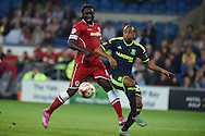 Kenwyne Jones of Cardiff city (l) challenges Emilio Nsue of Middlesbrough (r). Skybet football league championship match, Cardiff city v Middlesbrough at the Cardiff city stadium in Cardiff, South Wales on Tuesday 16th Sept 2014<br /> pic by Andrew Orchard, Andrew Orchard sports photography.