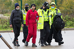 Hertfordshire Police officers arrest anti-HS2 activists who blocked an entrance to the Chiltern Tunnel South Portal site for the HS2 high-speed rail link for the entire day on 9 October 2020 in West Hyde, United Kingdom. The protest action, at the site from which HS2 Ltd intends to drill a 10-mile tunnel through the Chilterns, was intended to remind Prime Minister Boris Johnson that he committed to remove deforestation from supply chains and to provide legal protection for 30% of UK land for biodiversity by 2030 at the first UN Summit on Biodiversity on 30th September.