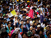 29 NOVEMBER 2017 - YANGON, MYANMAR:  People wait for the Papal Mass to start in Yangon. Hundreds of thousands of Catholics from Myanmar attended the mass said by Pope Francis at Kyaikkasan Sports Ground in Yangon Wednesday. Pope Francis is on the first visit by a Pope to Myanmar.   PHOTO BY JACK KURTZ