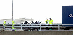 Licensed to UK  News in Pictures. Port of Dover Kent Monday 3rd July 2017  Two People have been left fighting for their lives after an over sea lorry driver ploughed into  their vehicle minutes after the pair had return from a weekend away.  The Romanian registered lorry was fallen laden on route to the ferry just after midnight on Sunday witnesses say the driver was on the wrong side of the road driving to the port when the incident happened late on Sunday evening. The main A2 into the port of Dover has been closed for nearly six hours and is likely to remain closed to aid with Police investigations and recovery of the lorry and the vehicle. Fire crews from Kent fire and rescue used specialist cutting equipment to gain access to the vehicle by removing the roof. Statement from Kent Police : The A2 Jubilee Way in Dover is currently closed in both directions from the Duke of York Roundabout to the Eastern Docks Roundabout while police investigate a serious collision.<br /> <br /> A car travelling up Jubilee Way was involved in a head-on collision with a lorry travelling down the road, near the entrance to the Eastern Docks.<br /> <br /> The incident happened at 11.55pm on Sunday 2 July.<br /> <br /> Jubilee Way is expected to be re-opened in the next hour or so. In the meantime, traffic heading to the Port of Dover is being diverted to the M20 and A20.<br /> <br /> Anyone who witnessed the collision and has not spoken to police is asked to contact the Serious Collision Investigation Unit on 01622 798538. ©UKNIP