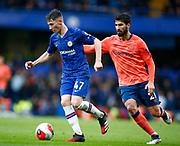 Chelsea's Billy Gilmour beats Everton's Andre Gomes during an English Premier League soccer match between Chelsea and Everton at Stamford Bridge stadium, Sunday, March 8, 2020, in London, United Kingdom. Chelsea defeated Everton 4-0. (Mitchell Gunn-ESPA Images/Image of Sport via AP)
