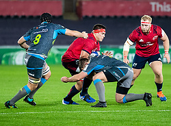 CJ Stander of Munster  is tackled by Olly Cracknell of Ospreys<br /> <br /> Photographer Simon King/Replay Images<br /> <br /> European Rugby Champions Cup Round 1 - Ospreys v Munster - Saturday 16th November 2019 - Liberty Stadium - Swansea<br /> <br /> World Copyright © Replay Images . All rights reserved. info@replayimages.co.uk - http://replayimages.co.uk
