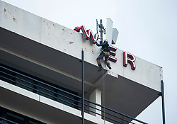"""© Licensed to London News Pictures; 11/06/2020; Bristol, UK. Contractors remove the letters """"Colston Tower"""" from the Colston Tower office block in the city centre, following renewed controversy over the name of 17th century slave trader and Bristol philanthropist Edward Colston. At a Black Lives Matter protest the previous Sunday the statue of slave trader Edward Colston which has stood in Bristol city centre for over 100 years was pulled down with ropes and thrown in Bristol Docks by protesters during the BLM rally and march through the city centre in memory of George Floyd, a black man who was killed on May 25, 2020 in Minneapolis in the US by a white police officer kneeling on his neck for nearly 9 minutes. Edward Colston (1636 – 1721) was a wealthy Bristol-born English merchant involved in the slave trade, a Member of Parliament and a philanthropist. He supported and endowed schools, almshouses, hospitals and churches in Bristol, London and elsewhere, and his name is commemorated in several Bristol landmarks, streets, three schools and the Colston bun. The killing of George Floyd has seen widespread protests in the US, the UK and other countries. Photo credit: Simon Chapman/LNP."""
