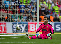 Football - 2016 / 2017 Championship Playoff Final: Reading vs. Huddersfield<br /> <br /> Danny Ward of Huddersfield Town sits and smiles after he guessed wrong with the first penalty at Wembley Stadium.<br /> <br /> COLORSPORT/DANIEL BEARHAM