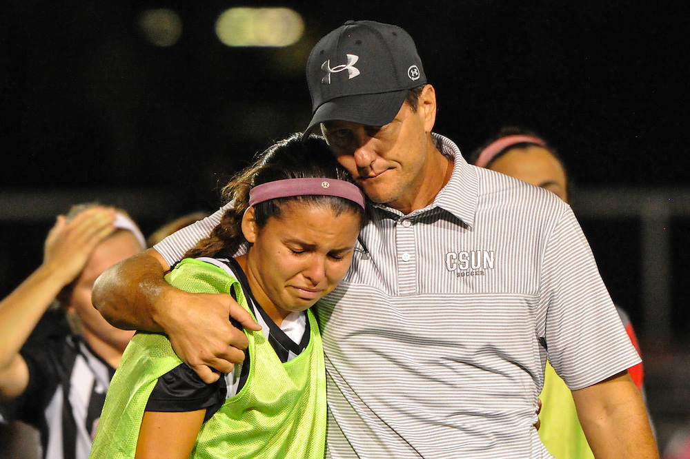 11/3/16 6:57:46 PM CSUN Matador head coach Keith West consoles a player after his team lost the Big West Tournament Women's Soccer Semi-finals against the Long Beach State 49ers at George Allen Field on the campus of Cal State Long Beach, in Long Beach, CA<br /> <br /> Photo by Joshua D. McKee