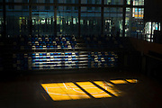 """Sunlight in empty sports hall, Sant Cugat del Valles, Barcelona. This mage can be licensed via Millennium Images. Contact me for more details, or email mail@milim.com For prints, contact me, or click """"add to cart"""" to some standard print options."""