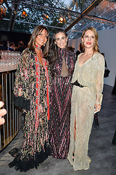 Left to right, COUNTESS DEBONAIRE VON BISMARCK, DEMI MOORE and EUGENIE NIARCHOS at British Vogue's Centenary Gala Dinner in Kensington Gardens, London on 23rd May 2016.