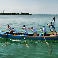 """VENICE, ITALY - SEPTEMBER 04:  Members of the Voga Veneta Lido rowing club practice on a """"Caorlina"""" a traditional Venetian boat ahead of Sunday Historic Regata on September 4, 2010 in Venice, Italy. The Historic Regata is the most exciting rowing race on the Gran Canal for the locals and one of the most spectacular ***Agreed Fee's Apply To All Image Use***.Marco Secchi /Xianpix. tel +44 (0) 207 1939846. e-mail ms@msecchi.com .www.marcosecchi.com"""
