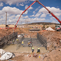 032213       Brian Leddy<br /> Workers from G. Sandoval Construction pour concrete for a new bridge on First Street in Grants Friday. The construction is the one of the larger public  works projects to be completed in recent years.