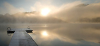 Dock at Alta lake, misty autumn morning in Whistler, BC Canada