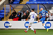 Coventry City defender Jordan Willis (4) can't stop Peterborough Utd forward Marcus Maddison (21) getting in a shot on the run during the EFL Sky Bet League 1 match between Peterborough United and Coventry City at London Road, Peterborough, England on 16 March 2019.