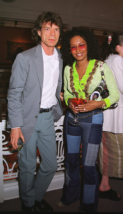 Rolling Stone MICK JAGGER and Spice Girl MEL B at a party in London on 22nd June 1999.MTP 4