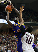 LSU forward Duop Reath (1) gets a shot off past Texas A&M center Tonny Trocha-Morelos (10) during the second half of an NCAA college basketball game Saturday, Jan. 6, 2018, in College Station, Texas. (AP Photo/Sam Craft)