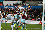 Sam Vokes of Burnley (far right) has his arm up and clearly handles the ball but referee Anthony Taylor thinks it is a Swansea city players arm and awards a penalty to Burnley by mistake. Burnley's Andre Gray goes on to score the penalty. Premier league match, Swansea city v Burnley at the Liberty Stadium in Swansea, South Wales on Saturday 4th March 2017.<br /> pic by Andrew Orchard, Andrew Orchard sports photography.