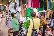 29 JULY 2014 - HAT YAI, SONGKHLA, THAILAND:  Malaysian tourists shop for clothes in the market in Hat Yai. Hat Yai is the 4th largest city in Thailand and the largest outside of the Bangkok metropolitan area. It's less the 50 miles from the Malaysian border and is a popular vacation spot for Malaysian and Singaporean tourists.       PHOTO BY JACK KURTZ