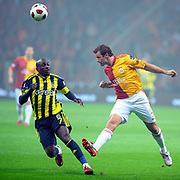 Galatasaray's Lucas NEILL (R) and Fenerbahce's Mamadou NIANG (L) during their Turkish superleague soccer derby match Galatasaray between Fenerbahce at the Turk Telekom Arena in Istanbul Turkey on Friday, 18 March 2011. Photo by TURKPIX
