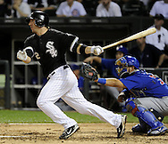 CHICAGO - JUNE 21:  Brent Morel #22 of the Chicago White Sox hits a sacrifice fly to drive in the eventual winning run in the seventh inning against the Chicago Cubs on June 21, 2011 at U.S. Cellular Field in Chicago, Illinois.  The White Sox defeated the Cubs 3-2.  (Photo by Ron Vesely)  Subject:  Brent Morel