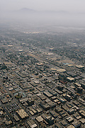 A haze of dust and smog hangs over the valley floor above Bakersfield.