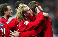 Ludovic DELPORTE , French Football player and Osasuna midfielder, celebrates a goal embracing his team mate Savo MILOSEVIC, forward of Serbia and Montenegro. Real Madrid - Osasuna / League 2005-06. Santiago Bernabeu Stadium, Madrid.