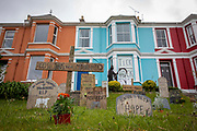 Climate related gravestones and a doomsday clock on display in the garden of house opposite the G7 media centre in Falmouth, on the 11th of June 2021 in Cornwall, United Kingdom.The current climate crisis is a key issue for many protestors and campaigners attending the summit.