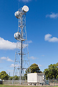 microwave parabolic dish antenna radio link on lattice tower with equipment shelter in Gumlu, Queensland, Australia <br /> <br /> Editions:- Open Edition Print / Stock Image