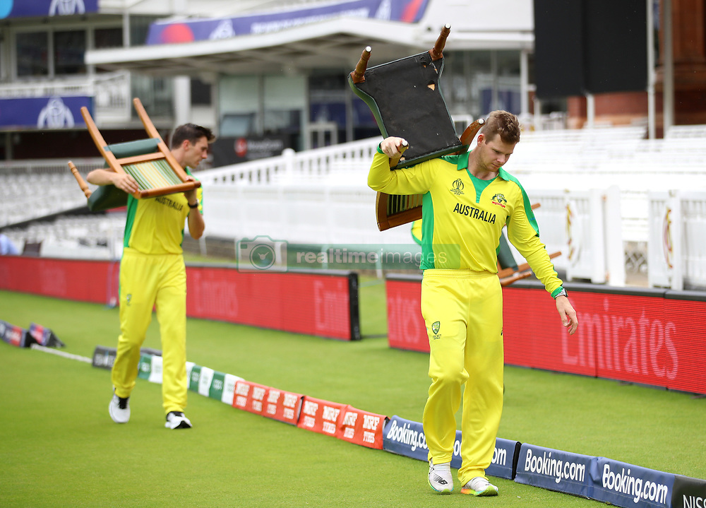 Australia's Steve Smith carries his chair back to the pavillion during a nets session at Lord's, London.