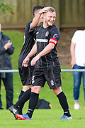 Waitakere City's captain Paul Rhodes is congratulated on scoring the opening goal of the game. ISPS Handa Chatham Cup Round 2, Waitakere City FC v Manukau City AFC, Fred Taylor Park, Whenuapai, Auckland, Monday 5th June 2017. Copyright Photo: David Joseph  / www.photosport.nz