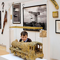 Picture shows: Matthew Sweeney of St Fillan's Primary School, Renfrewshire with a model of the Straw Locomotive...GEORGE WYLLIE RETROSPECTIVE: .IN PURSUIT OF THE QUESTION MARK..ARTIST'S LIFE LESS ORDINARY ON SHOW..THE life and work of George Wyllie, MBE, who died in May this year at the age of 90, is the subject of In Pursuit of the Question Mark, which is being curated by his elder daughter, Louise Wyllie...The exhibition is the most comprehensive survey of the internationally renowned Glasgow-born artist's work ever mounted and consists of almost 1000 objects. These range from his earliest drawings made for family when he was serving on HMS Argonaut in The Pacific during the Second World War, to his Cosmic Bunnet, made for his last ever solo exhibition in 2005...Wyllie described himself as a 'scul?tor' because, he said, the question mark should always be at the centre. His ambition as an artist, writer and philosopher was to bring art to the attention of the wider world with an engaging, and often humorous take on his chosen subjects...Some of the artist's earliest sculptural work has also been tracked down. This includes a Bumper Dolphin, made from old car bumpers, dating to the 1960s, and a peacock made from washers and scrap metal...The exhibition also features material which shows the process which led Wyllie to create iconic ephemeral works such as the Straw Locomotive and the Paper Boat...The Whysman Festival received funding from First in a Lifetime/Year of Creative Scotland 2012 to mount this exhibition and project-manage two community based projects; The Big Little Paper Boat Education Initiative which takes in over 90 Clydeside schools and the Big Clyde Question Project involving community groups in Inverclyde...GEORGE WYLLIE RETROSPECTIVE: IN PURSUIT OF THE QUESTION MARK.The Mitchell, North Street, Glasgow, G3 7DN.www.whysman.co.uk.3 November, 2012 - 2 February, 2013.Open Monday-Saturday, 10am-5pm