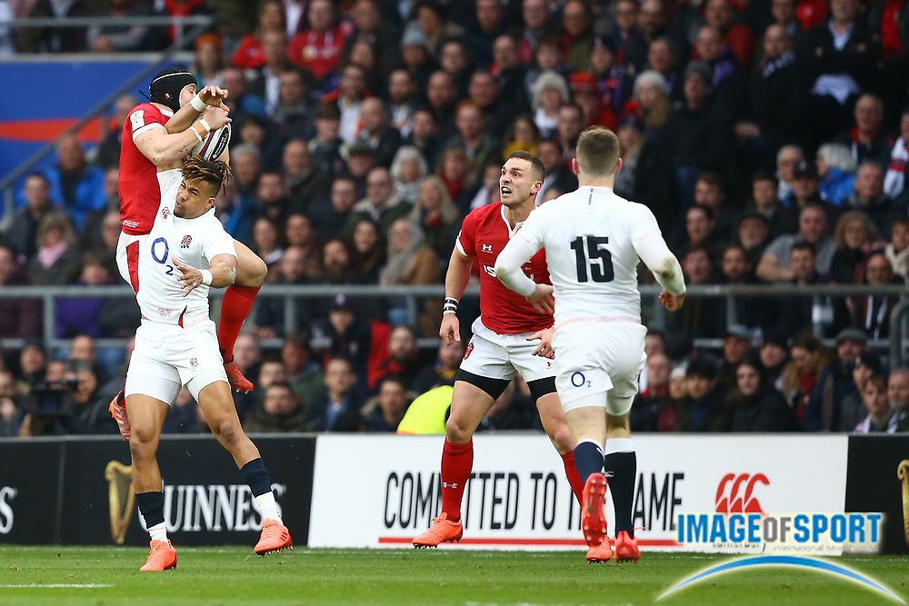 Leigh Halfpenny of Wales and Anthony Watson of England compete for the ball during the Guinness Six Nations between England and Wales at Twickenham Stadium, Saturday, March 7, 2020, in London, United Kingdom. (Mitchell Gunn-ESPA-Images/Image of Sport)