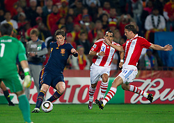 Fernando Torres of Spain vs Claudio Morel of Paraguay and Jonathan Santana of Paraguay during the  2010 FIFA World Cup South Africa Quarter Finals football match between Paraguay and Spain on July 03, 2010 at Ellis Park Stadium in Johannesburg. (Photo by Vid Ponikvar / Sportida)