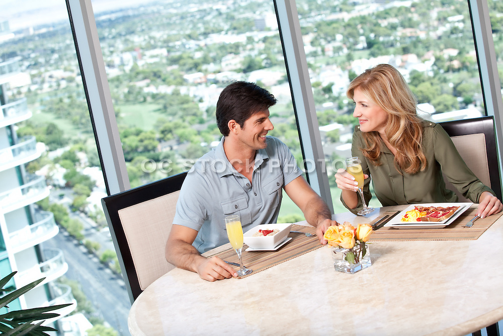Couple Having Brunch In High Rise Condo