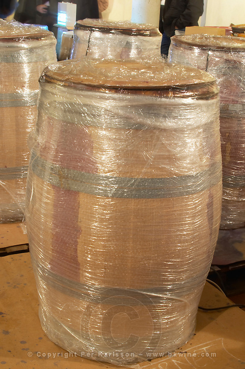 Red wine fermenting in barrels, barrel covered in bubble plastic to keep the heat better and increase extraction Domaine Vignoble des Verdots Conne de Labarde Bergerac Dordogne France