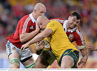 22 June 2013; Stephen Moore, Australia, is tackled by Paul O'Connell, left, and Alex Corbisiero, British & Irish Lions. British & Irish Lions Tour 2013, 1st Test, Australia v British & Irish Lions, Suncorp Stadium, Brisbane, Queensland, Australia. Picture credit: Stephen McCarthy / SPORTSFILE