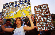 NEW YORK, NY: Demonstrators opposed to US military retaliation for the attack on the World Trade Center gather in Union Square in New York, Sept 21, 2001. Terrorists crashed two hijacked jetliners into the World Trade Center collapsing the towers on Sept 11, 2001, killing more 2,900 people. Union Square is the center of a memorial to the terrorists' victims and the anti-retaliation movement.    PHOTO BY JACK KURTZ