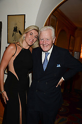 SIR BENJAMIN SLADE and BRIDGET CONVEY at a 1970's themed party as part of Annabel's 50th anniversary celebrations, held at Annabel's, Berkeley Square, London on 24th September 2013.