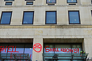 Climate change protesters spay graffiti on the entrance of Shell oil HQ on 15th April 2019 in London, United Kingdom.  Extinction Rebellion a climate change protest group are protesting  across the centre of London and plan to block traffic for the next five days.