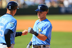 March 10, 2017 - Bradenton, Florida, U.S. - WILL VRAGOVIC   |   Times.Tampa Bay Rays first base coach Rocco Baldelli (15) fist bumps first baseman Jake Bauers (70) after his single in the fourth inning of the game between the Pittsburgh Pirates and the Tampa Bay Rays at LECOM Park in Bradenton, Fla. on Friday, March 10, 2017. (Credit Image: © Will Vragovic/Tampa Bay Times via ZUMA Wire)