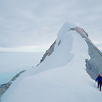 ANTARCTICA. Mountaineer Hector MacKenzie on first ascent of Mount Simmons in southern Ellsworth Mountains.  Vast polar icecap background.