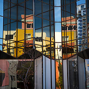 Buildings are reflected in other buildings in the Little Italy neighborhood of downtown San Diego.
