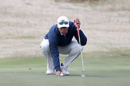 WILMINGTON, NC - MARCH 19: Kent State's Chase Johnson lines up a putt on the Ocean Course ninth hole. The first round of the 2017 Seahawk Intercollegiate Men's Golf Tournament was held on March 19, 2017, at the Country Club of Landover Nicklaus Course in Wilmington, NC.